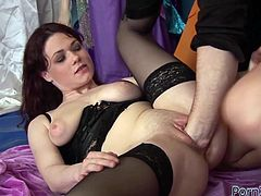 Slutty bitch is wearing tight black corset and nylon stockings while filming in hardcore fuck scene. She is getting rammed bad doggy style. Later on she is fisted bad.