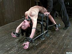 Lovely Micah Moore lies on some bondage device and get bounded. Her master toys her hot pussy so well that she gets sweaty.