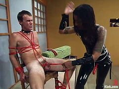 Sexy brunette Mistress Heart is having fun with Wild Bill indoors. She beats the dude with a stick and then binds him and pulls him by the prick.