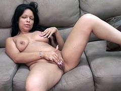 Well shaped Latina mommy with big ass and natural boobs displays her goodies on couch. Latina slut spreads her legs wide open and jams fat dildo in her soaking cunt.