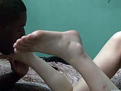 Extravagant white mistress takes doggy pose letting black guy lick her smelly soles. Then bitch lies on her back and gets her stinky cunt licked.