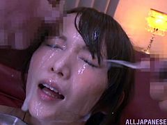 Look at all that semen on Hana's face! She's a pretty Japanese woman and loves to stay down on her knees, while men jerk around her. They give her all their cum and she enjoys how it feels. As the warm semen flows on her face, Hana wants more and more, playing with the jizz, and having a taste of it.