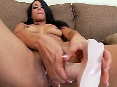 Sizzling brunette Layla Sin is getting naughty indoors. She strips and plays with her shaved pussy and then pounds it with a realistic toy.