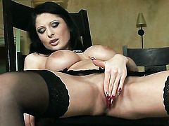 Alison Star with big breasts and shaved beaver has some time to stroke her muff
