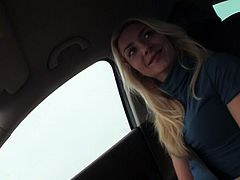 Nasty blonde whore exposes her natural tits while riding in car