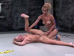 Holly Wellin and Isis Love are having a fierce struggle on tatami. They beat and pull each other by the hair and then Isis drills Holly's snatch with a strapon.