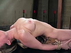 Pretty nude girl Lindsey Grant lets some man bind her in a basement. Then the dude toys Lindsey's lickable pussy and it makes the girl get a hot orgasm.