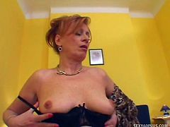 Redhead hooker Lady has fallen on hard times, and she has started doing the thing that she said that she never would - sucking and fucking black cocks!  Her stud for the day is a virile young buck with an absolutely massive pole, and there's a l