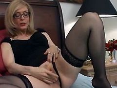 Blonde milf with huge boobs and sexy glasses amazes with her warm and puffy lips