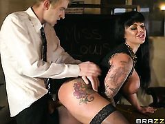Kerry Louise with massive melons puts her lips on Danny Ds dick and sucks it hard and deep