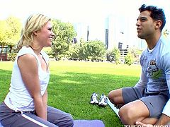 Appetizing blonde chick in flexes her body and starts doing her yoga exercises. One guy touches and strokes her big butt from time to time.