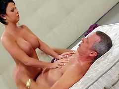 Attractive bombshell Loni Evans with colorful tattoos on back and big juicy hooters gives head to Tom Byron and rides on his rock hard sausage like there is no tomorrow.