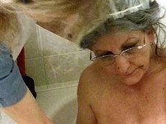 This spoiled granny is far from being shy! She spreads her legs wide indicating how bad she wants her friend to rub her hairy pussy.