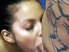 Sex hungry brunette gives blow job and hand job to one bald headed tattooed dude. She licks his balls with only one desire to get a portion of slime cum dessert.