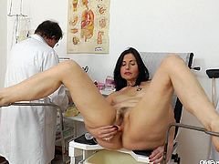 This mature lady has gone in to see the doctor to make sure everything is in working order when it comes to her vagina. She sticks a tube up her first and puffs up her pussy lips they the gynecologist douches her dirty pussy.