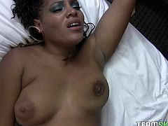 White dude gets lucky to fuck voluptuous ebony hooker. Black babe plays with her big boobs while taking white dick up her black poon missionary style.
