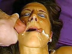 After having her holes ravaged in threesome, naughty gal gets covered in jizz