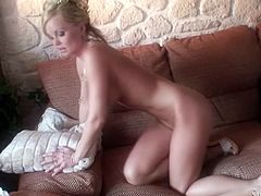 Charming blonde Silvia Saint takes her white lingerie off and demonstrates her delicious pussy. Then she sucks her fingers passionately and masturbates her pussy with them.