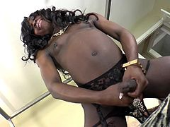 She's black and she's hot! Tranny Brii is a chocolate beauty with a hard cock and a very sexy ass. The dark shemale shows us all in her very own kinky way. Check her out how she reveals her body and how she self pleasures. Curious if she will give herself a big load of cum on those black thighs?