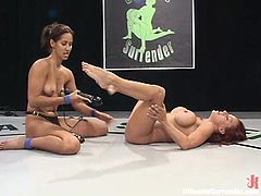 Busty redhead Shannon Kelly is loving the moves of a strapon