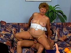 Chubby blonde granny Virginia is trying hard to satisfy some guy. She sucks and rubs his boner devotedly and then gets fucked in cowgirl and missionary positions.