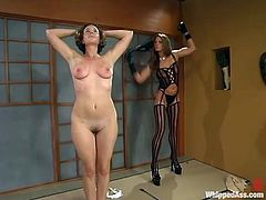 Kym Wilde is having fun with May-Anne indoors. Kym undresses may and then whips her with a lash and dominates her.