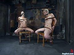 Two hot chicks get pinched and toyed by their master