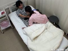 Lovely Asian girl in pink nurse uniform gives a handjob to big cocked patent. Then she starts to sucks that cock with pleasure.
