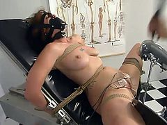 Slutty chick gets tied up in a medical office. She gets her tits tortured with different bondage devices. Then she also gets her pussy toyed and wired.