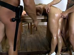 Skanky student is talked over by her teachers for hardcore MMF threesome. She gets greased up in oil all over. She then fucked hard doggy style.