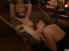 Lewd blonde Iona Grace is having fun with some guys in the presence of many people. She spreads her legs wide and gets her cunt and ass toyed and fisted like never before.
