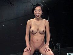 Beautiful Asian chick Tia Ling gets shackled in a basement. Then some guy puts pumps on her tits and clit and fucks her snatch with a dildo afterwards.
