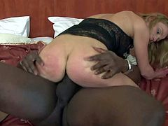 Mature blonde cougar Suzy with natural boobies and good looking body in black lace blouse makes out with black bull and has orgasm while he stuffs her twat with monster cock.