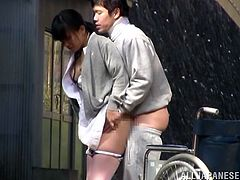 Horny Asian nurse has sex with a patient outdoors