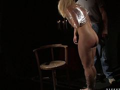Curvaceous blonde slave babe lies on her master's lap all naked while he spanks her big ass and finger bangs her tight asshole.