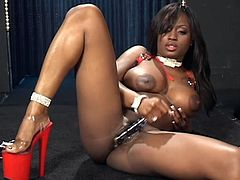 Curvy ebony hottie Jada Fire is getting naughty indoors. She plays with her big boobs and pets herself and then pounds her coochie with a dildo.