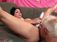 Curvaceous Latina lies on a sofa with her legs wide opened. She toys her pussy and gets fingered. After that she gives a blowjob and a titjob.