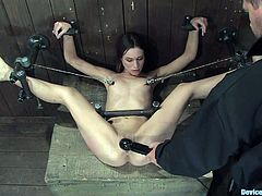 The BDSM session with a smoking hot babe Amber Rayne! Her petite ass is being drilled with a toy, while she is trapped in the bondage device!
