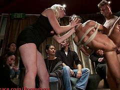 Watch a hot ebony slave getting tied up and passed around during a wild sex party. See the horny white studs and a vicious blonde belle making ample use of her sweet clam!