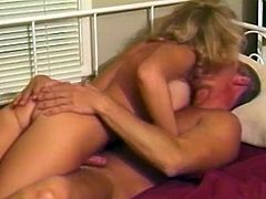 Hot blonde milf Tamara is having fun with some guy indoors. She sucks and rubs the dude's weiner like never before and then enjoys ardent sex in side-by-side position.