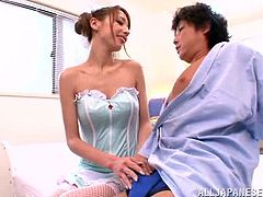 Slim Japanese girl in sexy nurse uniform fucks her patient. She gives him a blowjob and massages her juicy tits. Then this hottie gets fucked in a cowgirl pose.