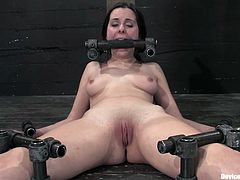 Slim brunette cutie Winter Sky is getting naughty with some guy in a basement. She lets the man immobilize her and then gets her shaved snatch drilled with a dildo.