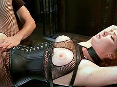Owen Gray ties up Audrey Hollander and spreads her legs. She is wearing sexy fishnets and her legs are spread apart with rope. He plays with her clit and then, she gets a huge cock inside her pussy. He fucks her, while wearing a leather mask.