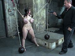 Brunette chick gets her gigantic boobs twisted with ropes. Then a guy also shoves a hook in her ass and also toys the pussy with a vibrator.