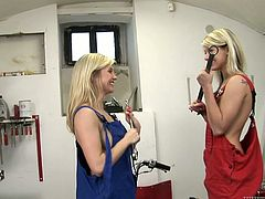 Gorgeous blondes have a lesbian scene in a garage