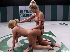 Holly Heart and Krissy Lynn fight fiercely in a ring. Krissy loses, so Holly toys her vagina deep and hard with a strap-on.