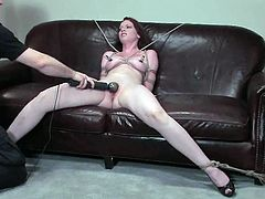 Redhead cutie Amber Keen enjoys some tortures indoors