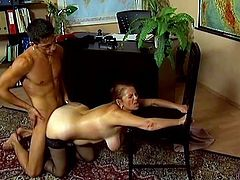 Curvy mature bitch Linda is having fun with some guy at her work place. She gives him a blowjob and then gets banged doggy style and her big natural tits bounce back and forth.