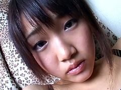If this Asian cutie doesn't make you horny, nothing will. Watch and enjoy how she starts to rub her clit and then fingers her tight pussy for a nice orgasm.