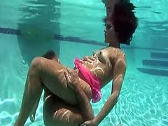 She immerses her man in the pool and gives him a nice blowjob. Then he fucks her in there. Keeping air in lungs is pretty easy for her.